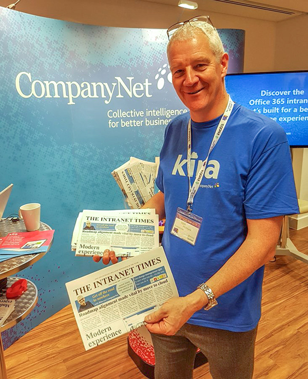 Iain hands out copies of our 'Intranet Times' newspaper